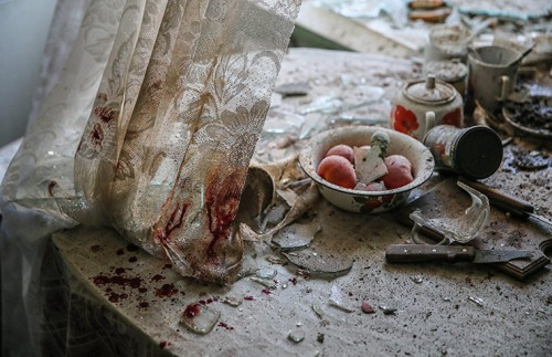 Damaged goods lie on a kitchen table in a house in Donetsk, Ukraine